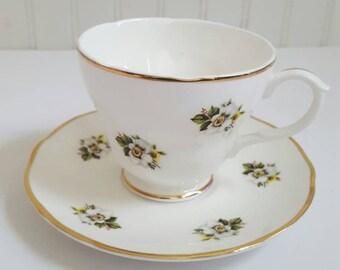 Vintage Vista Alegre teacup saucer yellow floral pattern