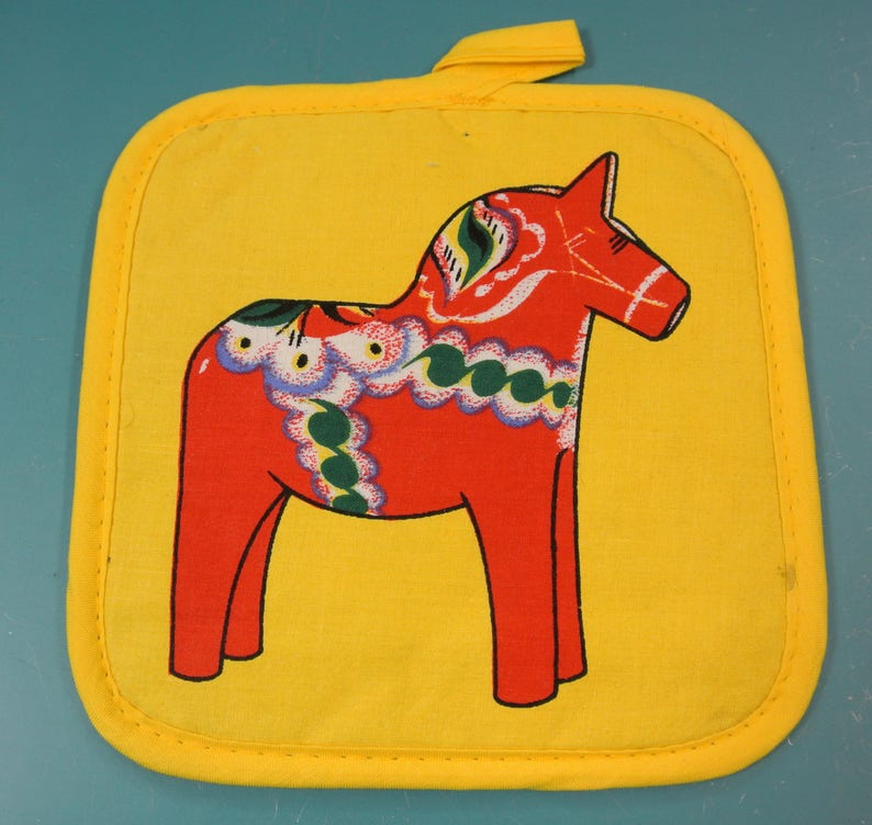 Swedish vintage 1970s printed design cotton fabric potholder with red green white Sweden Dalarna dalahorse motive on strong yellow bottom