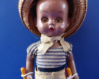 1960s Hard Plastic Doll. Sweet Little Caribbean Boy With Maracas, with Original Costume and Raffia Hat