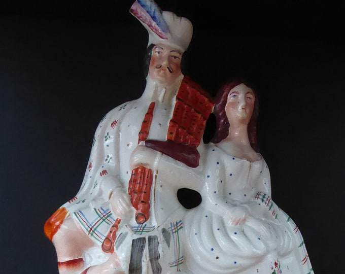 ANTIQUE Victorian Staffordshire Flatback Figurine. A Highlander and his Sweetheart Sitting on a Clock Face. Poor Man's Clock