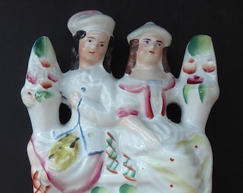 ANTIQUE Victorian Staffordshire Figurine. Poor Man's Clock. Two Highland Figures with Fruiting Vine