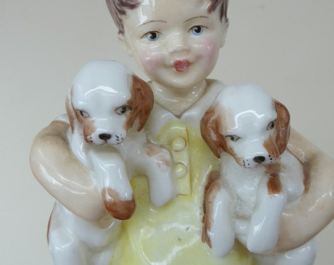 Royal Worcester Figurine. ALL MINE.  Modelled by Freda Doughty. No 3519. Boy Holding Puppies. PRISTINE