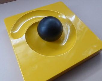 ARTEMIDE MILANO. 1969 Classic Italian Design by Eleonore Peduzzi Riva;  Spiral / Spyros Ashtray. Yellow Plastic with Black Ball