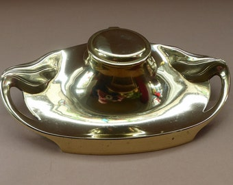 ART NOUVEAU / JUGENDSTIL Brass Inkwell with tendril handes and feet. Marked Geschutzt on the Base