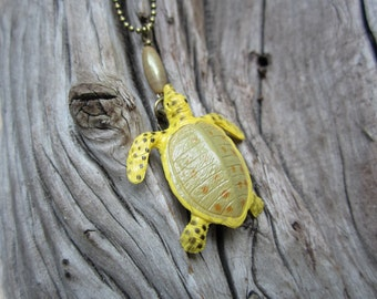 Pond turtle necklace with bronze bar and ball chain