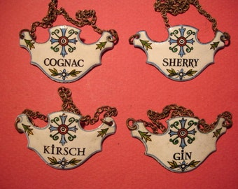 Four Fine French Enamelled Wine Labels