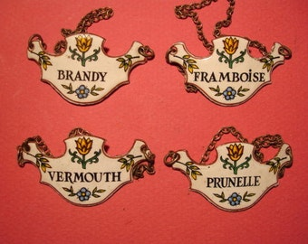 Four Very Pretty Enamelled Wine Labels