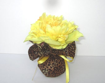 Single Yellow Peony In An Animal Print Fabric Covered Vase