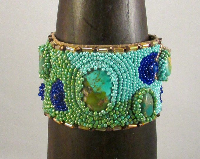 Beaded cuff bracelet with turquoise cabochon