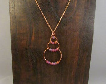 Copper wire bubble necklace with purple beads