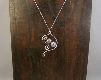 Black pearl necklace with silver swirls