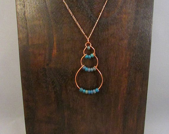 Copper wire bubble necklace with dark blue beads