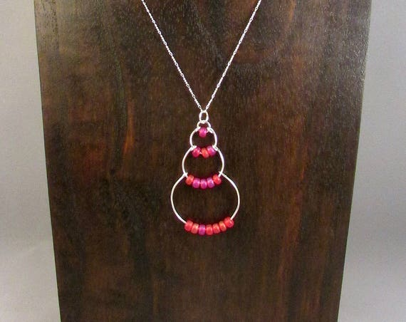 Silver wire bubble necklace with pink beads