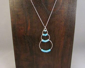 Silver wire bubble necklace with light blue beads