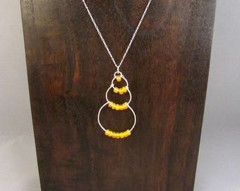Silver wire bubble necklace with yellow beads