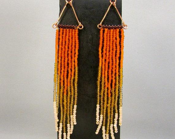 Beaded fringe earrings in orange
