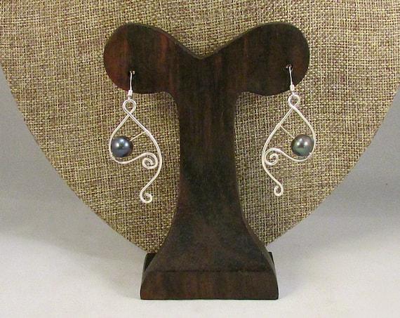 Black pearl earrings with silver swirls