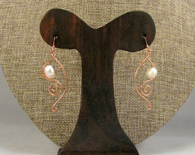 White pearl earrings with copper swirls