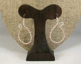Silver paisley outline earrings