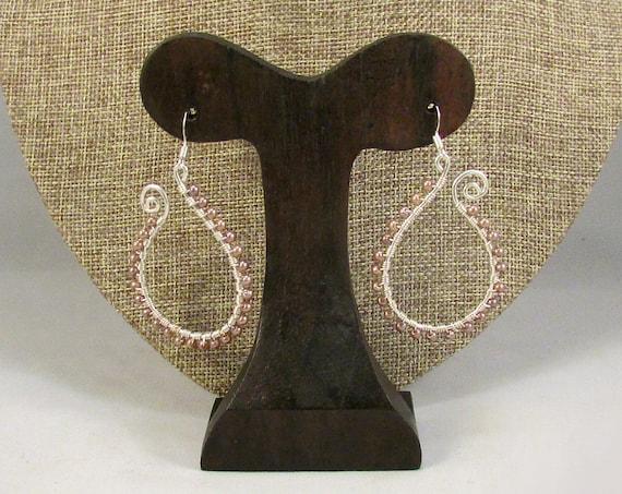 Silver paisley outline earrings