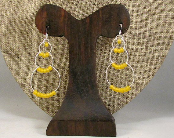 Silver wire bubble earrings with yellow beads