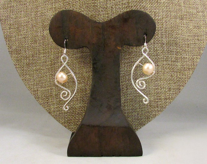 Pink pearl earrings with silver swirls