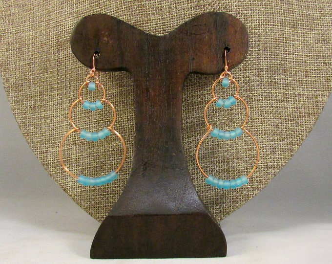 copper wire bubble earrings with light blue beads