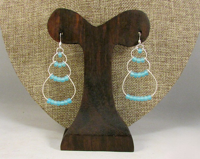 Silver wire bubble earrings with light blue beads