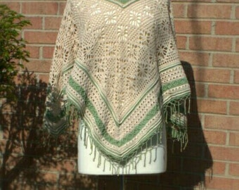 Crocheted poncho with flower motif