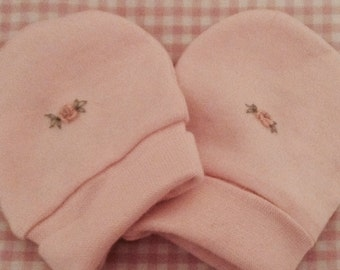 Pink embroidered newborn mittens for baby girl. One size fits all.