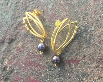 Flower stud earrings in silver and gold plated silver