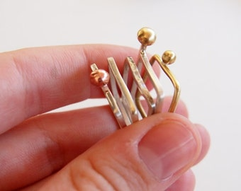 Stackable ring set made out of 5 square silver rings