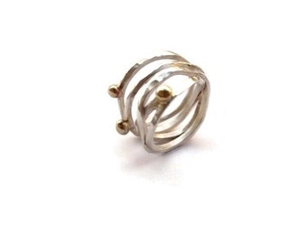 Silver wire ring with bronze dots