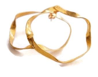 Large gold-plated ribbon hoop earrings