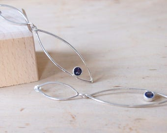 Silver earrings with blue iolite stone