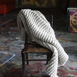 Chunky Knit Blanket or throw that is made with hand spun natural wool, natural grey color, as seen in Apartment Therapy