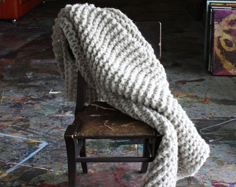 Chunky Knit Blanket made with hand spun natural wool, chunky blanket in natural grey color as seen in Apartment Therapy, living room decor