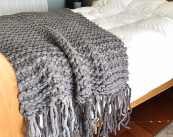 Chunky blanket throw made with natural hand spun wool with felted tassels, this chunky knit is warm and cozy, great living room decor