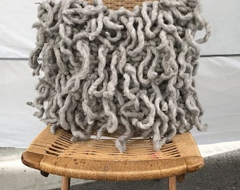 Decorative pillow with wool fringe, the Medusa Pillow, this beautiful home decor makes a nice housewarming gift and has a feather insert