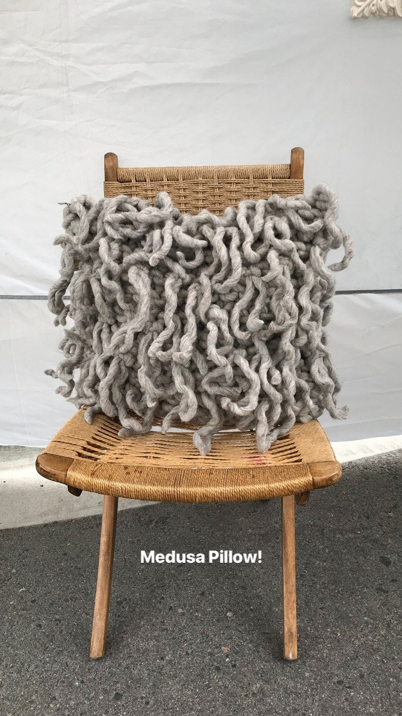 Decorative pillow with wool fringe the Medusa Pillow this image 0