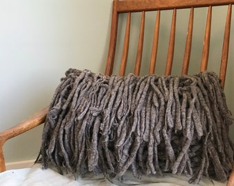 Chunky knit pillow with wool fringe, this throw pillow is a beautiful living room decor piece or great for the bedroom