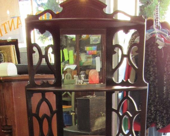 Mahogany corner curio shelf