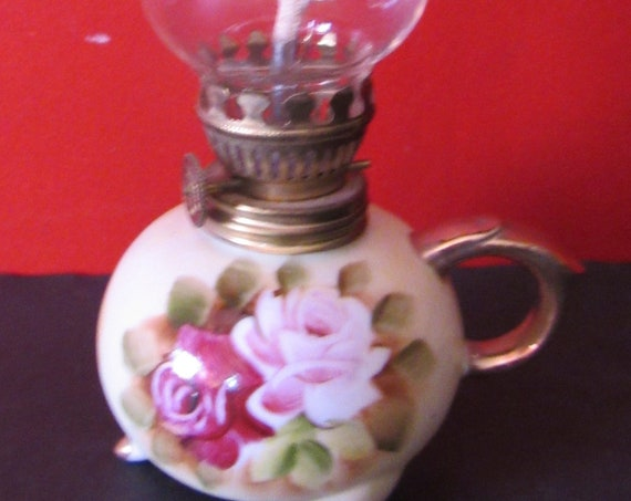 Miniature oil lamp by Norleans