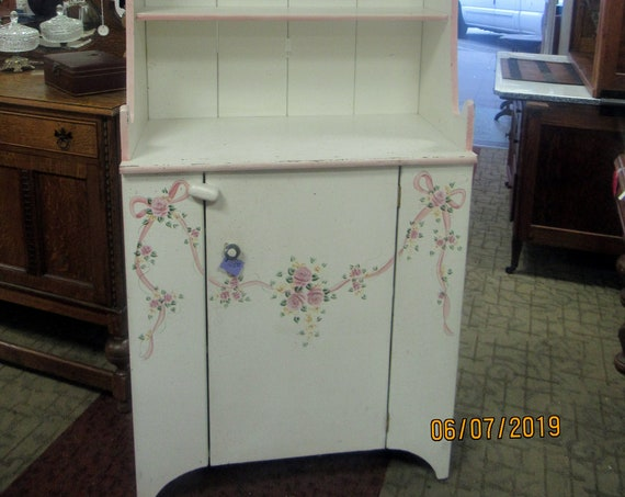 White and pink hutch cabinet