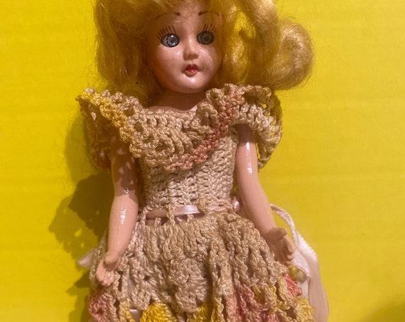 Tiny hard plastic doll