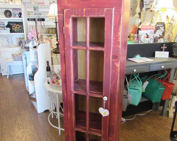 Red Cabinet with shelves and door