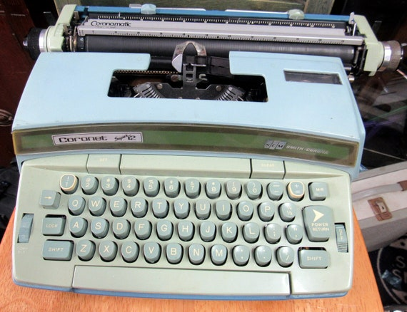 Smith Corona Coronet Super 12 electric typewriter and case