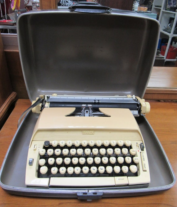Portable typewriter by Sears