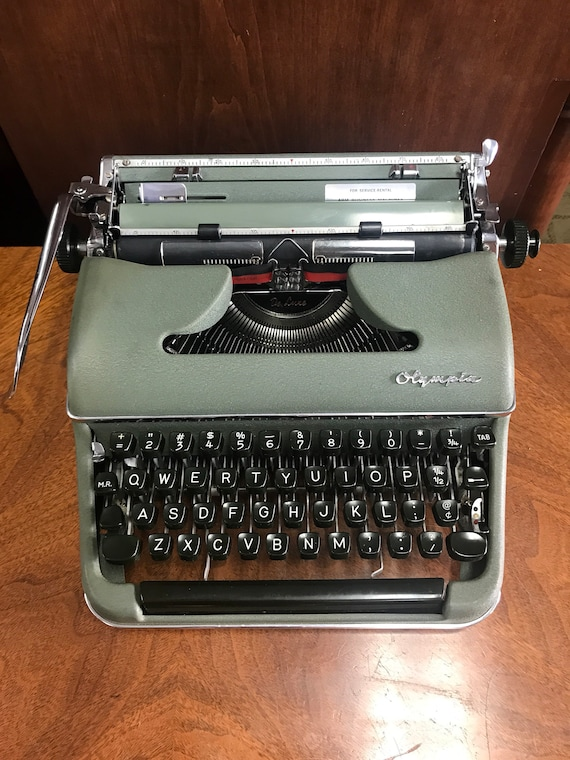 Green Olympia typewriter with metal case