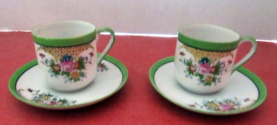 Pair of Occupied Japan demitasse cups and saucers